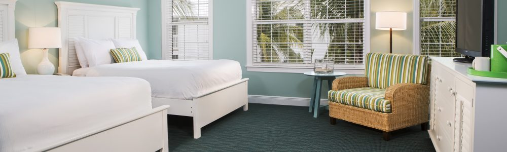 Garden view guestroom with two queen beds.