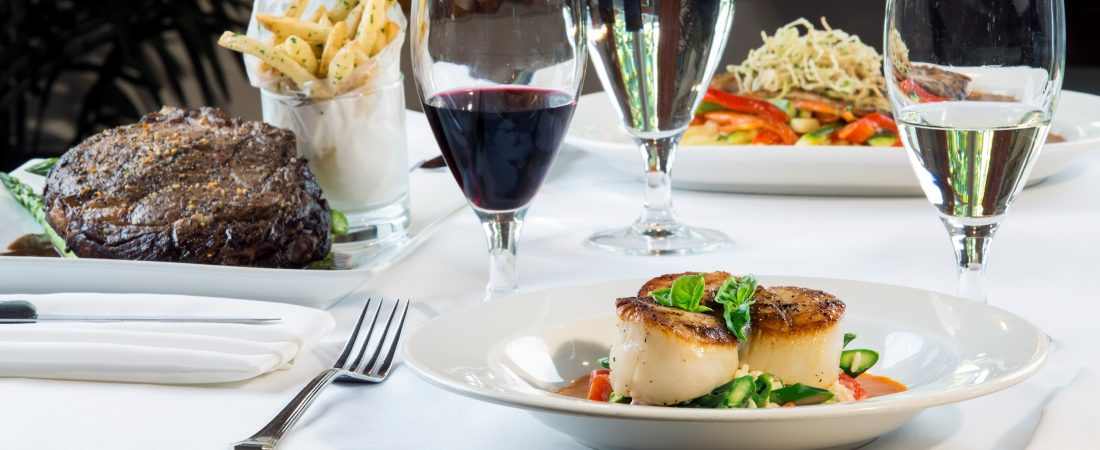 Seared scallops, steak and french fries, and wine at The Butterfly Cafe.