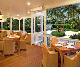 Dining tables on a terrace at Tranquility Bay.